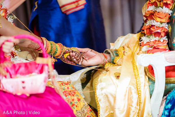 Indian groom and bride holding hands