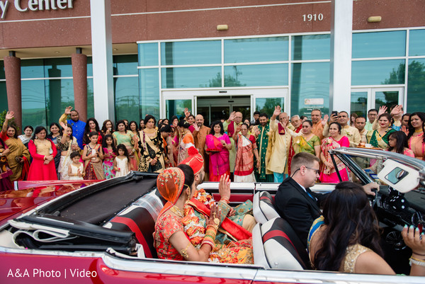 Indian groom and bride leaving the ceremony