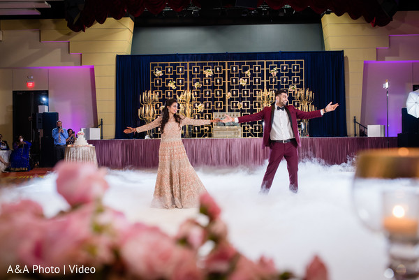 Indian bride and groom dancing for the guests