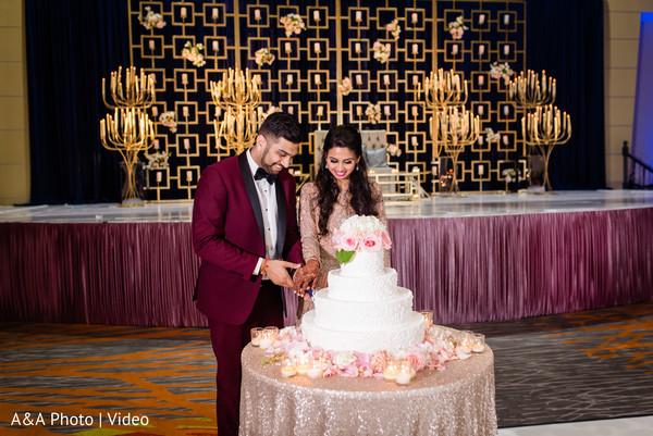 Maharani and Raja cutting the cake
