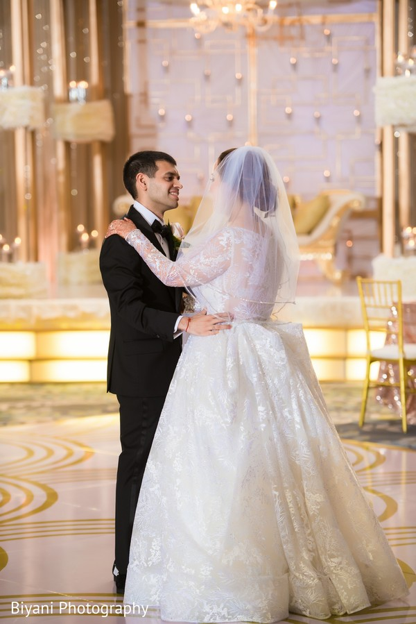 Indian bride having her first dance with groom