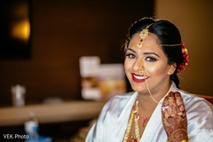 See this lovely Indian bride getting ready capture.