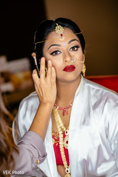 Incredible Indian bride having her makeup done.