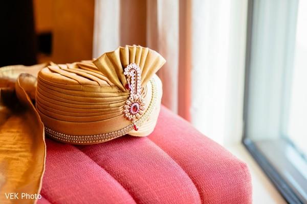 Elegant Indian groom's turban with jewelry.