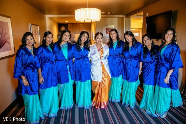 Lovely Indian bride and bridesmaids getting ready.