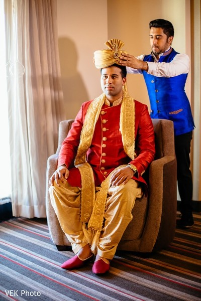 Indian groom getting his turban on.