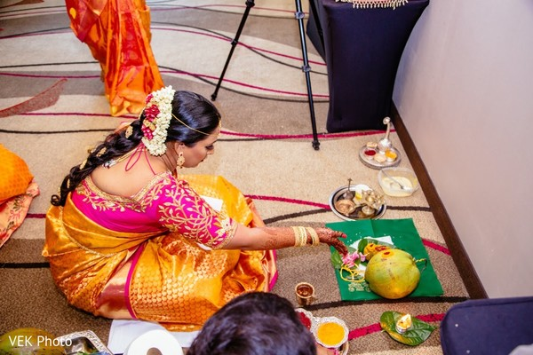 Maharani making offerings to altar before ceremony.