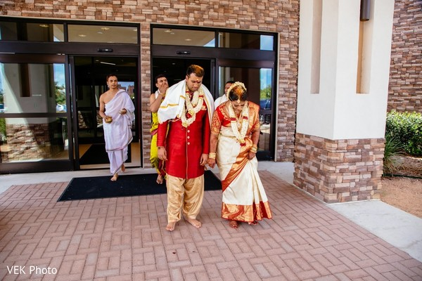 Indian couple outdoors for wedding ceremony rituals.