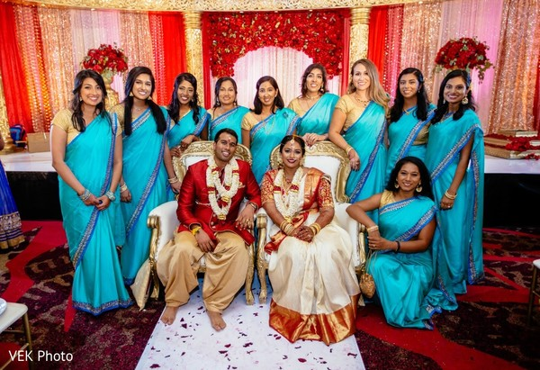 Indian bride, groom  and bridesmaids posing for photo shoot.