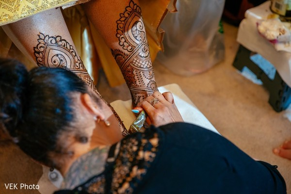 Indian bride getting her hanna art done.