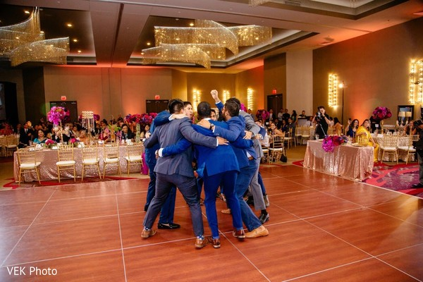 Upbeat Indian groomsmen at reception party.