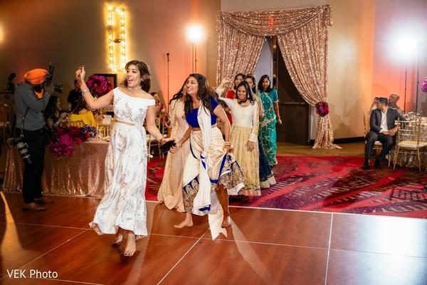Indian bridesmaids entrance to reception party.