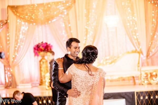 Joyful Indian bride and groom dance capture.