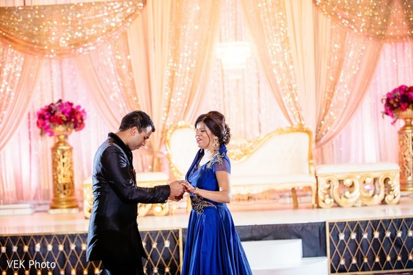 Indian groom dancing with his mother capture