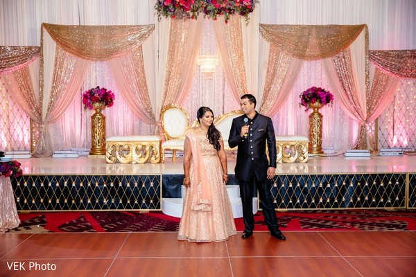 Indian bride and grooms capture during reception speech.