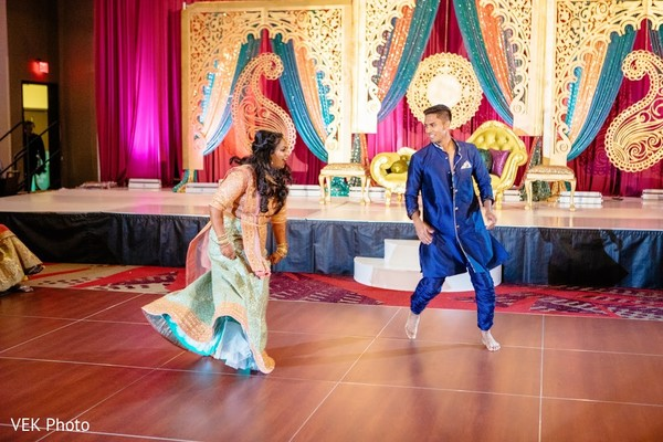 Adorable indian bride during sangeet dance.
