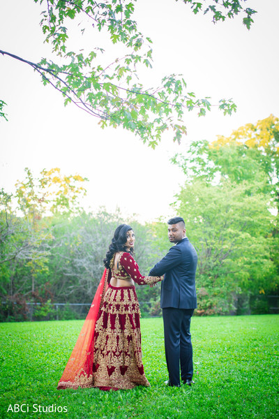 See this lovely Indian couple walking outdoors.