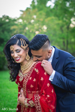 Gorgeous Indian bride  and groom out in garden capture.