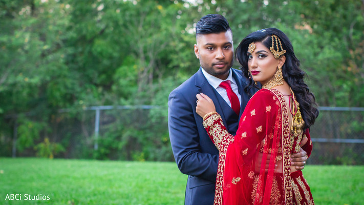 Dazzling Indian bride and groom outdoors capture.