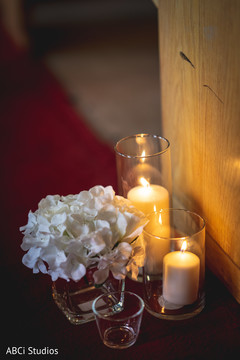 Marvelous Indian wedding Church flowers and candles decor.