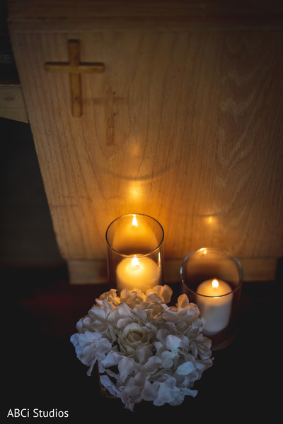 Elegant Indian wedding Church flowers and candles decor.
