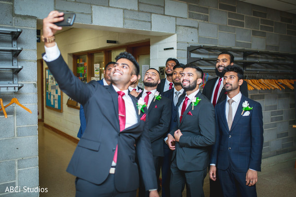 Indian groomsmen taking a selfie.