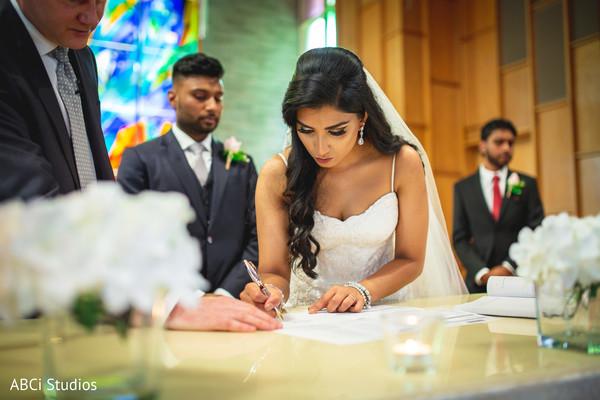 Maharani signing the wedding ceremony act.