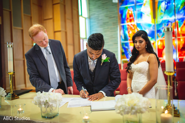 Rajah signing the wedding ceremony act.