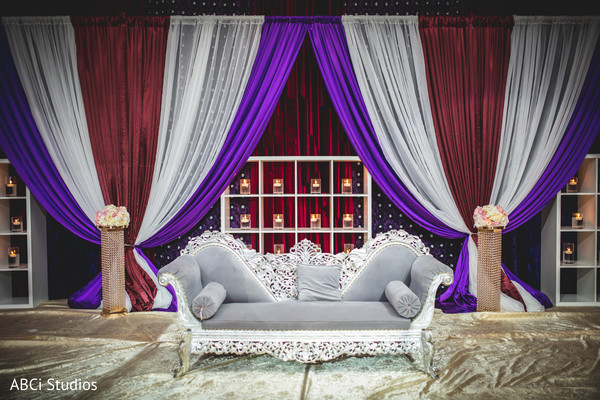 Stunning Indian wedding reception draping and stage decor.