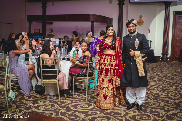 Stunning Indian couple's wedding reception entrance.