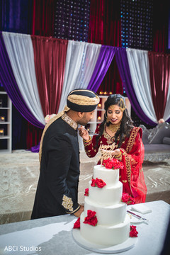 Indian bride giving cake to the groom lovely capture.