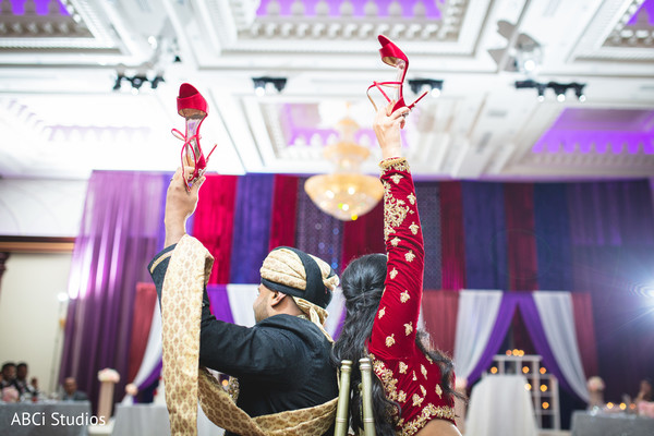 See this fun Indian wedding reception game.