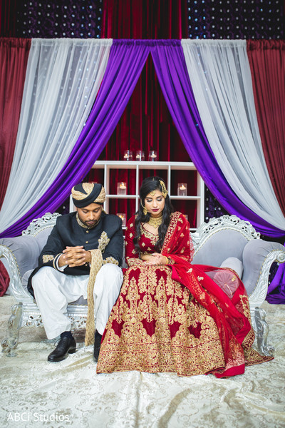 Indian bride and groom praying capture.