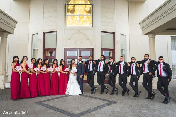 Ravishing Indian couple with bridesmaids and groomsmen.