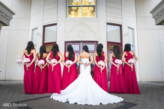 Sweet Indian bride and bridesmaids posing for photo shoot.