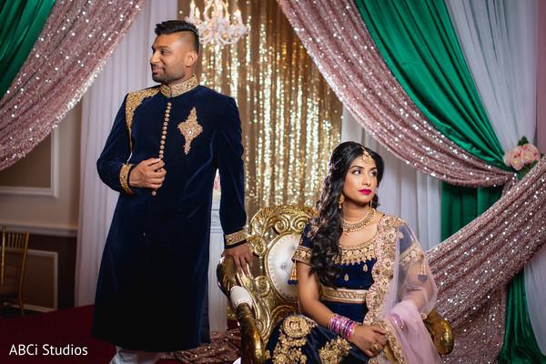 Glamorous Indian couple posing for photoshoot.