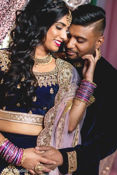 Tender Indian bride and groom shot.