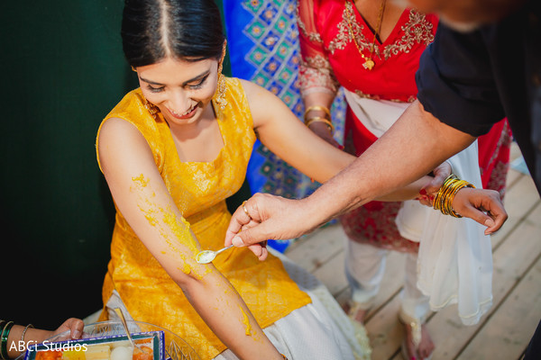 Indian bride getting the turmeric paste on.