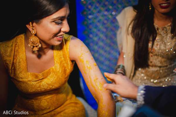 Maharani with turmeric paste all over her.