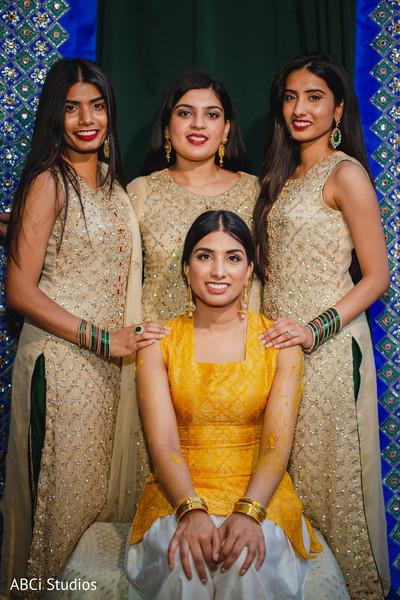 Maharani with bridesmaids at the haldi party.