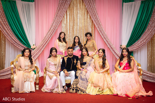 Sweet Indian bridesmaids posing with maharani and rajah for photo.