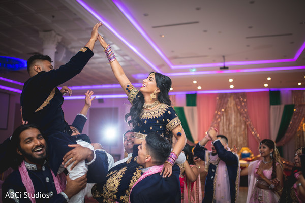 Indian bride and groom at reception celebration captured.