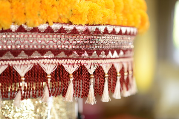 Indian sangeet flowers and embroidery close up capture.