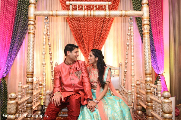 Adorable Indian bride and groom face at sangeet.