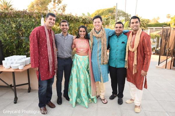 Dazzling Indian bride and groomsmen portrait.
