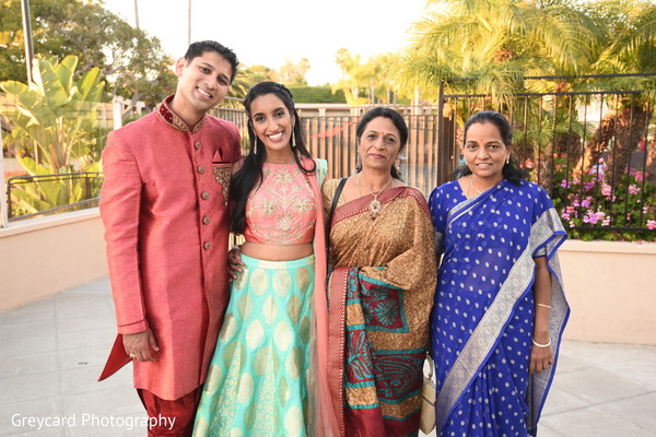See this lovely Indian couple posing with relatives.