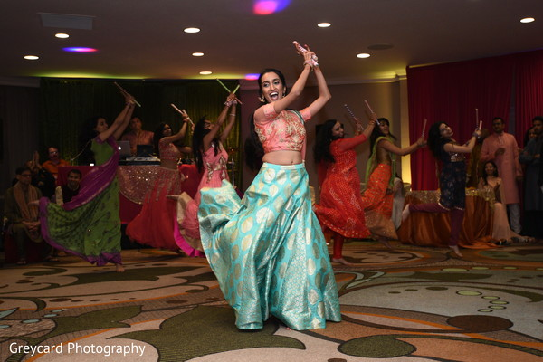 Dazzling Indian bride and bridesmaids at a sangeet dance.
