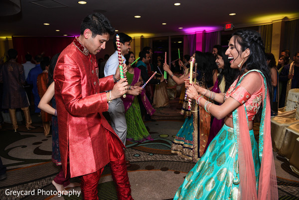 Indian bride and groom at their garba dance.
