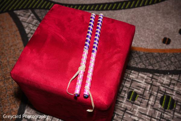 Closeup capture of pink and purple dandiya raas sticks.