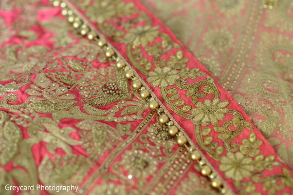Closeup capture of Indian bridal lehenga.